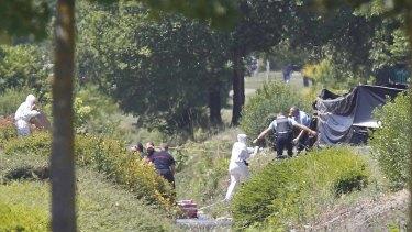 French crime scene investigators examine the site where the remains were located.