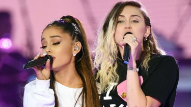 Ariana Grande and Miley Cyrus performing at the One Love Manchester concert.