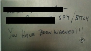 A message left on a toilet wall.