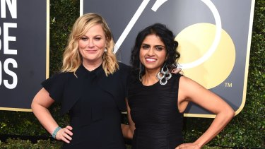 Amy Poehler, left, and Saru Jayaraman arrive at the 75th annual Golden Globe Awards at the Beverly Hilton Hotel on Sunday, Jan. 7, 2018, in Beverly Hills, California.