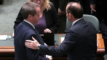 Bill Shorten and Tony Abbott in discussion after delivering statements on Malaysian Airlines flight MH17: No time for partisanship.