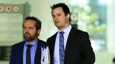 Defence lawyer Dennis Kinsella (left) and his associate leave court.