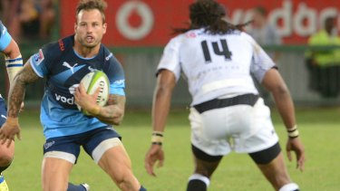 Evasive action: Francois Hougaard of the Bulls takes on the Sharks defence.
