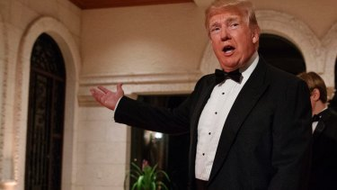 US President Donald Trump arrives for a New Year's Eve gala at his Mar-a-Lago resort in Palm Beach, Florida.