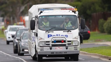 The prison truck carrying five men accused of trying to join Islamic State heads to court from the airport.