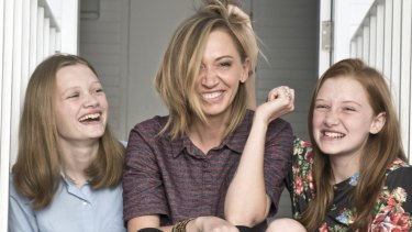 Renae Smith and her daughters Kyah and Paris at home in Newtown. Renae changed her mind about immunising her daughters.