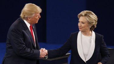 Hillary Clinton shakes hands with Donald Trump after the second debate.