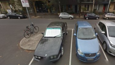 Google Street View from April, 2014 showing Mark Anderson's blue Volkswagen Polo in one of the set of eight permit zone parking bays on Leveson Street.