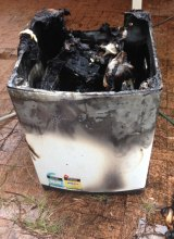 The remains of the Samsung washing machine that caught fire in a Corlette home in May.