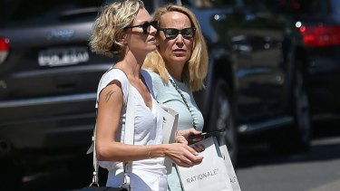 Sarah Murdoch helps Mother-in-law Jerry Hall shop in Sydney.