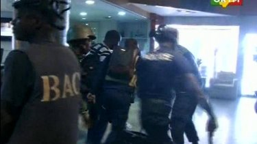 Security forces help hostages to safety, inside the Radisson Blu Hotel in Bamako. This image was taken from Mali TV ORTM.
