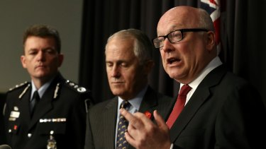 AFP Commissioner Andrew Colvin, former communications minister Malcolm Turnbull, Attorney-General George Brandis.
