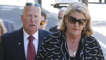 Constable Bill Crews' parents - Kel and Sharon Crews - arrive at the Coroner's Court in Glebe on Monday.