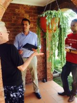 On the campaign trail: Labor candidate for Mulgoa Todd Carney speaking to a local woman.