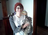 Kim with Mikey, her crotchety but much-loved cat.