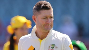 Australian cricket captain Michael Clarke wears a black armband during a ceremony to pay tribute to Phillip Hughes.
