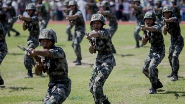 A rising power: People's Liberation Army soldiers practise in Hong Kong in July. China's army hasn't seen real combat in decades.