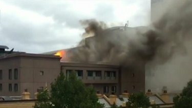 Flames and black smoke were visible at a building blaze in Haymarket on Monday.
