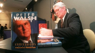 Peter Walsh signs copies of his book at the National Press Club in 1995.