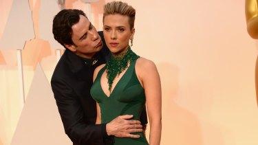 John Travolta embraces (albeit creepily) Scarlett Johansson – the woman in possession of the world's best body.