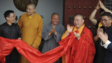 Claims against him: Shi Yongxin, third from right, in the red and yellow robes.