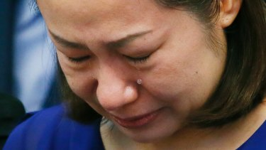 Choi Kyung-jin, the widow of South Korean businessman Jee Ick-joo, cries at the start of the Philippine Senate probe into the killing in Pasay City on Thursday.