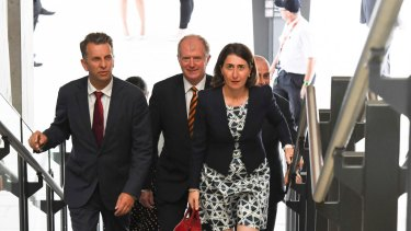 Andrew Constance, left, Sydney Trains chief executive Howard Collins and Premier Gladys Berejiklian at Leppington on Monday.