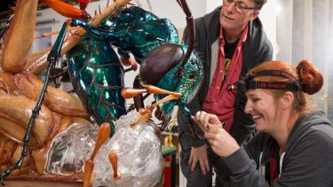 Weta Workshop founder Richard Taylor and technician Antje Goehring with the jewel wasp.