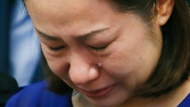 Choi Kyung-jin, the widow of South Korean businessman Jee Ick-joo, who was kidnapped and later killed by his abductors, cries at the start of the Philippine Senate probe into the extra-judicial killing The abductors were identified as active police officers.