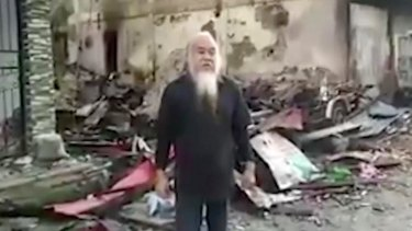 """This image made from undated militant video appears to show Father Teresito """"Chito"""" Suganob."""