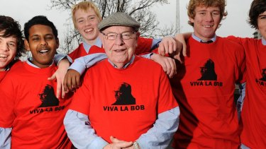 Father Bob with students modelling his T-shirts for a Sunday Run Melbourne, a fundraiser, in 2010.