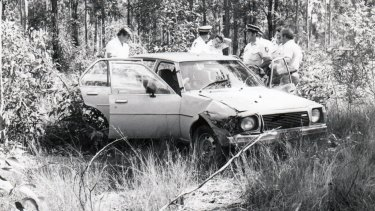 Police at the scene where Elizabeth Dixon was murdered in 1982.