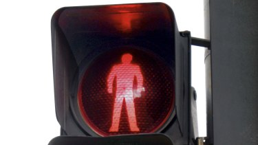 Drivers face longer waits at red lights under the pedestrian safety plan.