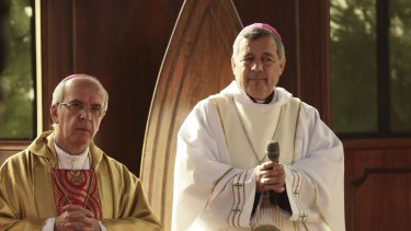 Bishop Juan Barros, right, in the cathedral in Osorno.