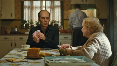 Johnny Depp as ''loving family man'' Whitey Bulger and Mary Klug as Ma Bulger in <i>Black Mass</i>.