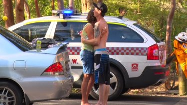 Nick Weston, who held the man after he fell from the top of Somersby Falls, comforts the man's mother.