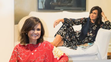 Lisa Wilkinson with Peter Smeeth's portrait  that won the Packing Room Prize at the Archibald Prize.