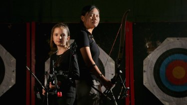 Archers Faith Hastie (left) and Denise Pilien at the Moorabbin Archery Club.