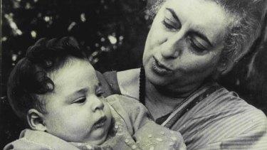 India's then Prime Minister Indira Gandhi fondles her grandson Rahul Gandhi, aged five months, in November,1970.