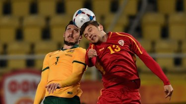 Mathwe Leckie of Australia and Stefan Ristovski of FYR Macedonia go up for a header during the International Friendly in Skopje on Tuesday.