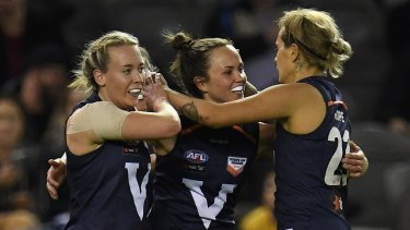 AFLW in good state: Lauren Arnell, Daisy Pearce and Moana Hope celebrate a Big V goal.