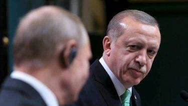 Turkish President Recep Tayyip Erdogan, right, listens to Russian President Vladimir Putin, left, following their meeting in Ankara, Turkey, also on Monday.