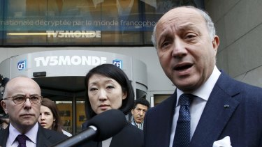 French Foreign Affairs Minister Laurent Fabius (right).