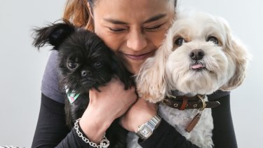 Dr Cherlene Lee and her dogs, (black dog) Obi-Wan-Kenobi and Siao Chuwho.