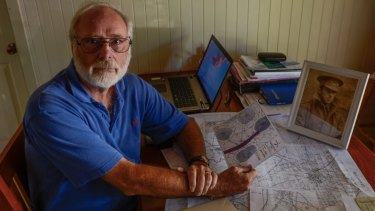 Peter Norton with his maps of battle fields at Bullecourt.