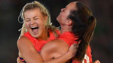 Sarah Jolly and Daisy Pearce celebrate a goal.