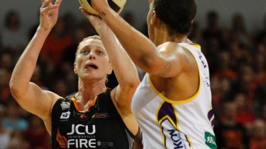 Suzy Batkovic (left) played a starring role for Fire in the grand final decider against the Boomers at Townsville Stadium.