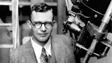 Clyde Tombaugh with the telescope through which he discovered Pluto, at the Lowell Observatory on Observatory Hill in Flagstaff, Arizona, in 1931.