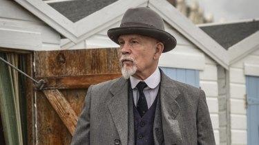 John Malkovich as Hercule Poirot.