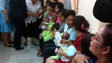 Thai nannies holding nine suspected surrogate babies after a police raid at a residential apartment on the outskirts of Bangkok, Thailand, last year.
